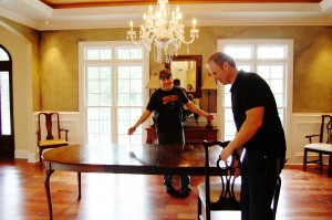 Lance and Billy moving furniture for a scene.......