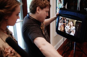 Billy showing Emmy a preview of what we just filmed on Scarlet Cord before filming the next scene