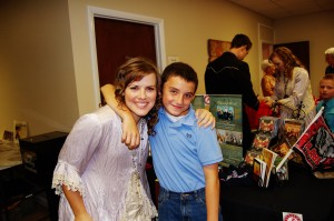 Lindsay and Ryan....a little friend from the camp meeting